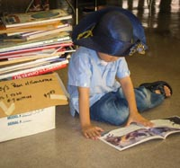 child-blue-hat-reading.jpg